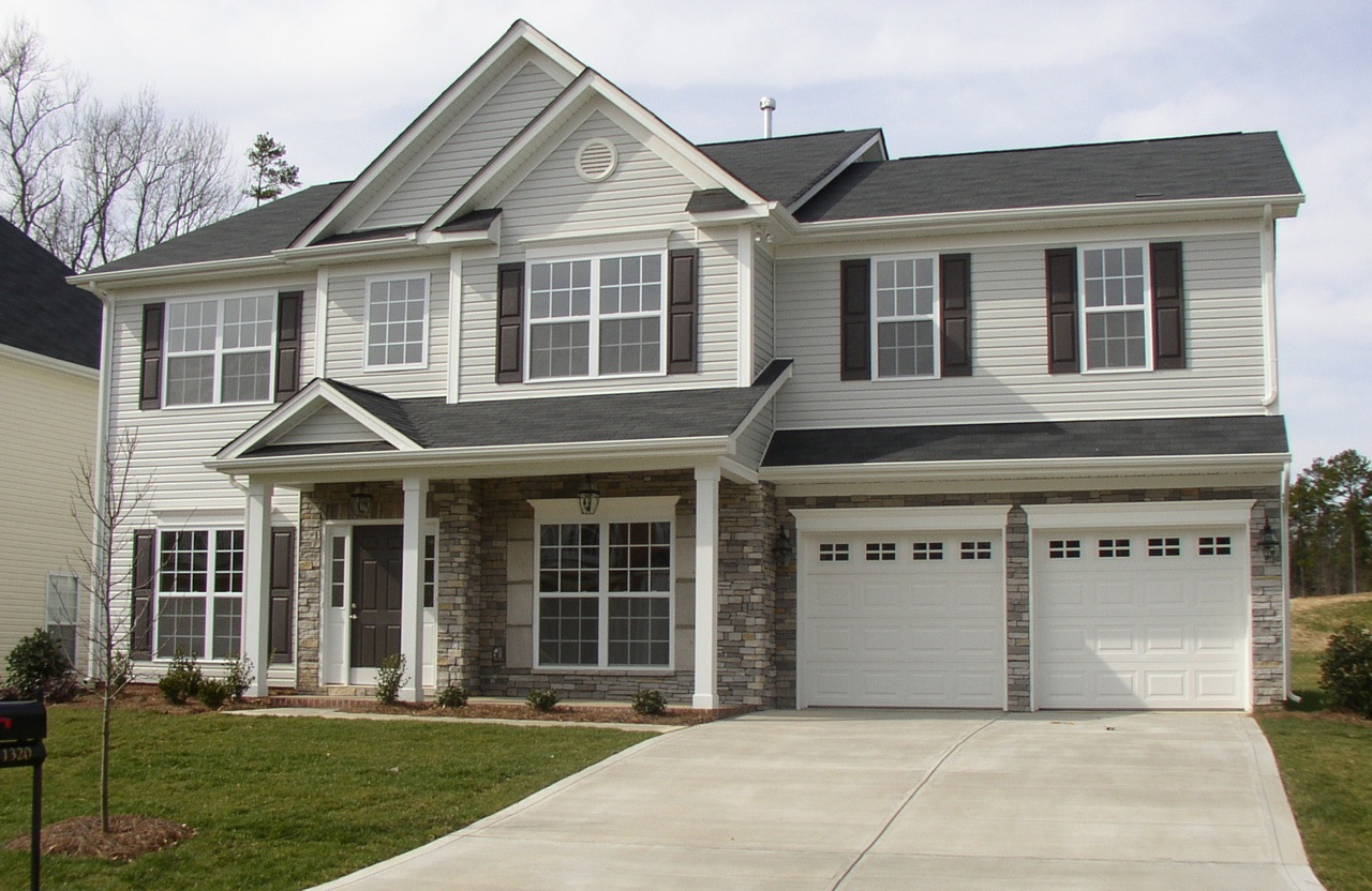 Color scheme. Light gray siding. White garage doors and trim. Gray stone  with some beige in it, dark gray roof and door. http://color4charlotte.f